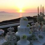 Fotografi matrimonio Napoli. Sposi al tramonto. Torta nuziale. Confettata all'aperto. Matrimonio a Villa Eliana. Buffet dei dolci matrimonio